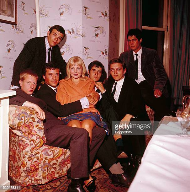 The cast of the film 'The GirlGetters' aka 'The System' including Oliver Reed Barbara Ferris and David Hemmings posed together on set in England in...