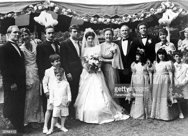 The cast of the film 'The Godfather' pose for a family portrait during the wedding scene in a still from the film directed by Francis Ford Coppola...