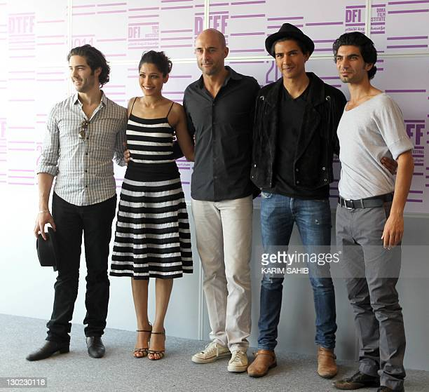 The cast of the French film Black Gold Tahar Rahim Freida Pinto Mark Strong Jan Uddin and Akin Gaziattend the photo call for their new movie at the...