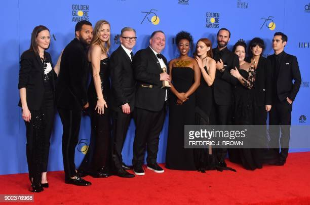 TOPSHOT The cast of 'The Handmaid's Tale' pose with the trophy for Best Television Series Drama during the 75th Golden Globe Awards on January 7 in...