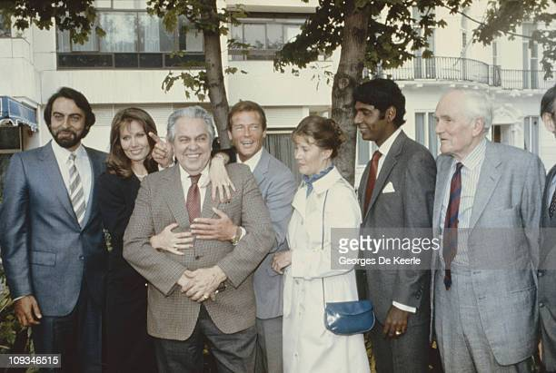 The cast of the James Bond film 'Octopussy' 1983 From left to right Kabir Bedi Maud Adams producer Albert R Broccoli Roger Moore Lois Maxwell tennis...