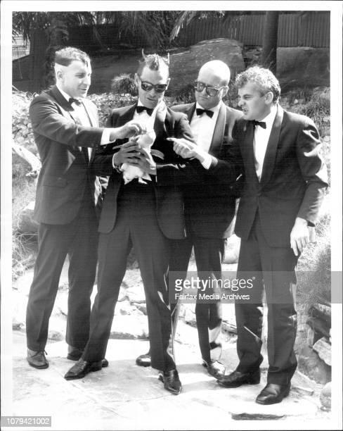 The Cast of the Kinsellas production Bouncers attempting to feed Penguins at Taronga Zoo today Tony Martin Scott McGregor Bob Baines Tony Taylor...