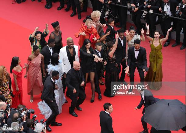 The cast of the movie 'Climax' dance on the red carpet prior the screening of 'Blackkklansman' during the 71st annual Cannes Film Festival at Palais...