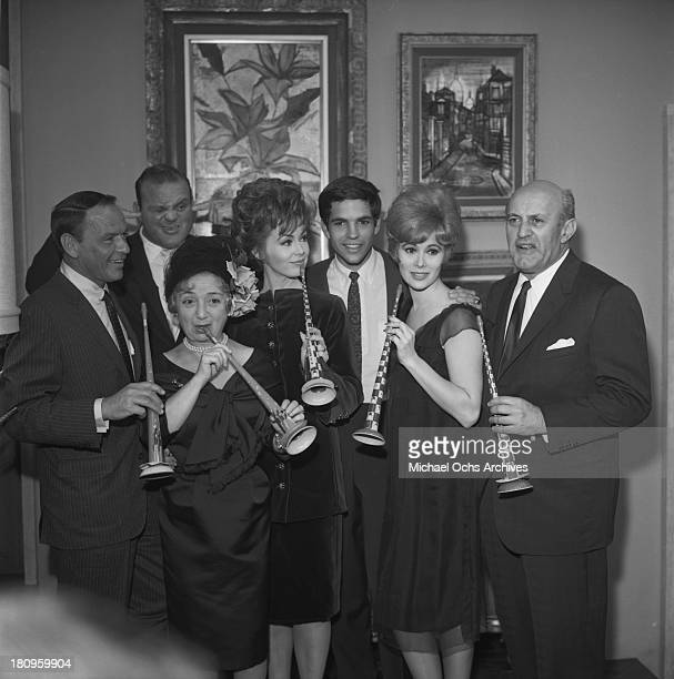 The cast of the movie 'Come Blow Your Horn' Frank Sinatra Dan Blocker Molly Picon Barbara Rush Tony Bill Jill St John and Lee J Cobb pose for a...