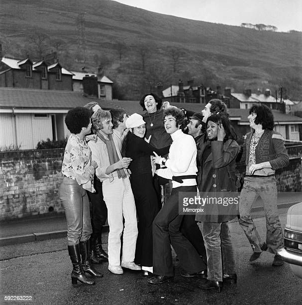 The cast of the musical Hair led by Victor Spinetti chair mum Mrs Lilian Spinetti at her home in Cwm South WalesDecember 1969 Z11746002