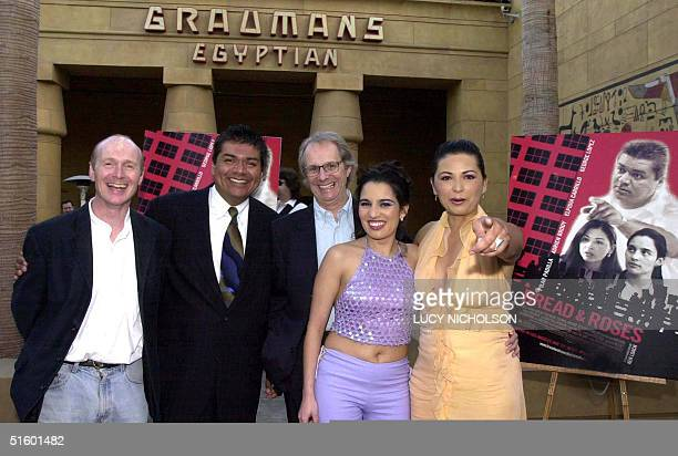 The cast of the new film Bread and Roses pose at the premiere at the Egyptian Theatre in Los Angeles 08 May 2001 Writer Paul Laverty actor George...
