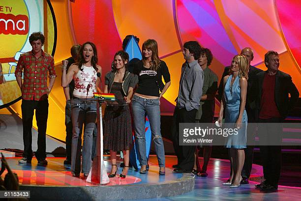 The cast of the 'OC' accept the Choice TV Show award on stage at The 2004 Teen Choice Awards held at Universal Amphitheater on August 8 2004 in...
