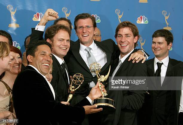 """The cast of """"The Office"""" raises President of NBC Entertainment Kevin Reilly in the press room at the 58th Annual Primetime Emmy Awards at the Shrine..."""