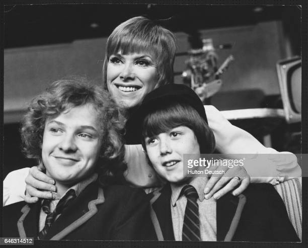 The cast of the television show And Mother Makes Three Robin Davies Wendy Craig and David Parfitt 1974