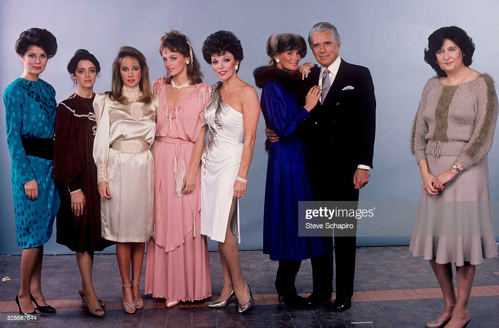 The cast of the television show Dynasty with screenwriter and producer Esther Schapiro (far right). From left Deborah Adair, Kathleen Beller, Pamela Bellwood, Pamela Sue Martin, Joan Collins, Linda Evans, John Forsythe and Esther Schapiro.