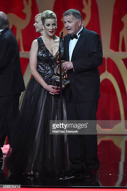 The cast of the tv show 'In aller Freundschaft' are seen on stage during the Bambi Awards 2014 show on November 13 2014 in Berlin Germany