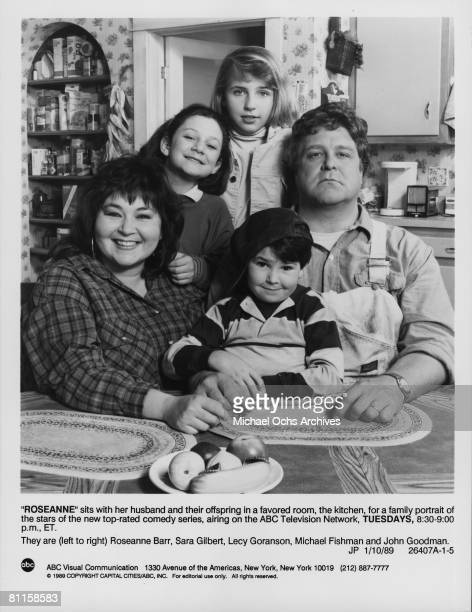 The cast of the tv sitcom 'Roseanne' They are Roseanne Barr Sara Gilbert Lecy Goranson Michael Fishman and John Goodman