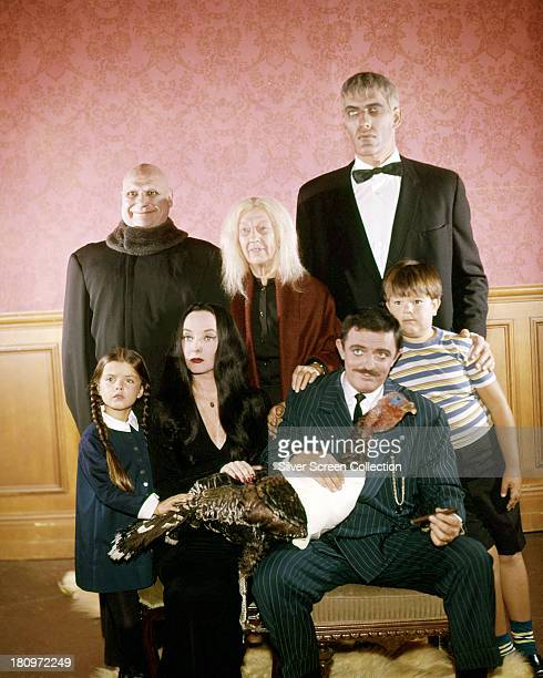 The cast of the US TV comedy horror series 'The Addams Family' circa 1965 Back row left to right Jackie Coogan as Uncle Fester Blossom Rock as...