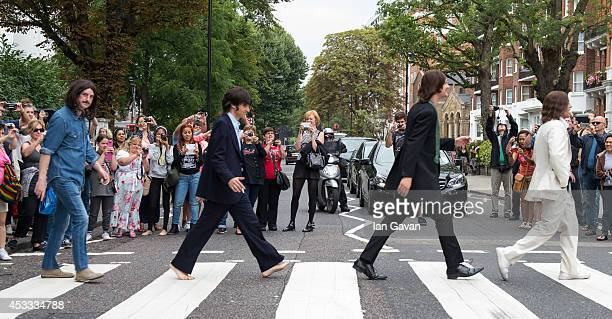 The cast of the West End Beatles show Let It Be cross the zebra crossing outside Abbey Road Studios during a photocall to celebrate The Beatles 45th...