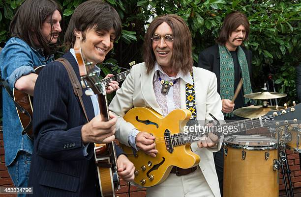 "The cast of the West End Beatles show ""Let It Be"" perform outside Abbey Road Studios during a photocall to celebrate The Beatles 45th Anniversary at..."
