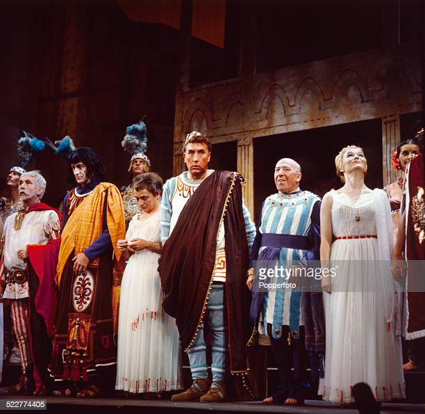 The cast of the West End production of the musical 'A Funny Thing Happened on the Way to the Forum' line up on stage at the Strand Theatre in London...