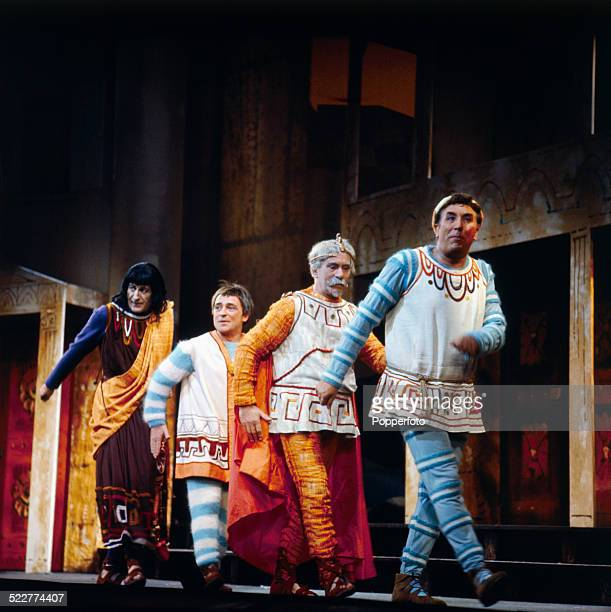 The cast of the West End production of the musical 'A Funny Thing Happened on the Way to the Forum' march on stage at the Strand Theatre in London in...