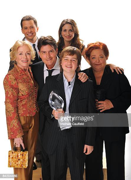 The cast of Two and a Half Men Holland Taylor Jon Cryer Charlie Sheen Marin Hinkle Angus T Jones and Conchata Ferrell pose for a portrait during the...