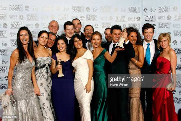 "The cast of ""Ugly Betty"" pose with their Best Television Series - Musical or Comedy award for ""Ugly Betty"" backstage during the 64th Annual Golden..."