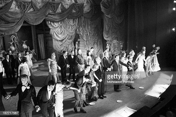 The cast of 'Un marziano a Roma' on the stage at the end of the performance is thanking the audience Teatro Lirico Milan November 23 1960