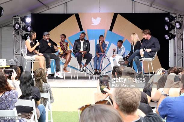 The cast of 'Us' Jordan Peele Lupita Nyong'o Winston Duke Shahadi Wright Joseph Evan Alex Elisabeth Moss and Tim Heidecker on stage with Twitter's...