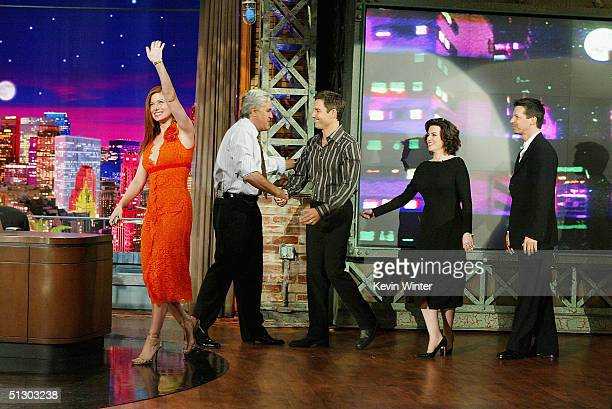 The cast of 'Will and Grace' Debra Messing host Jay Leno Sean Hayes Megan Mullally and Eric McCormack appear on 'The Tonight Show with Jay Leno' at...