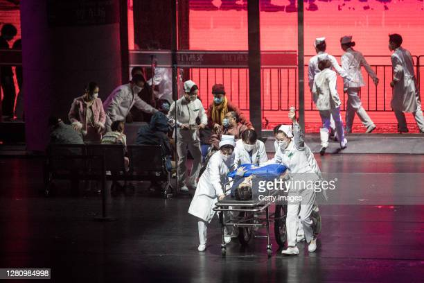 The cast perform as medical staff treating COVID19 patients on stage during the opera Angel's Diary on October 18 2020 in Wuhan Hubei province China...
