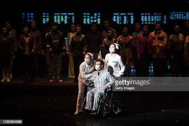 The cast perform as medical staff treating patients of COVID19 during the opera Angel's Diary on October 18 2020 in Wuhan Hubei province China The...