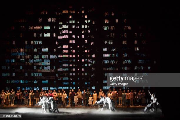 The cast perform as medical staff treating patients of COVID19 on stage during the opera Angel's Diary on October 18 2020 in Wuhan Hubei province...