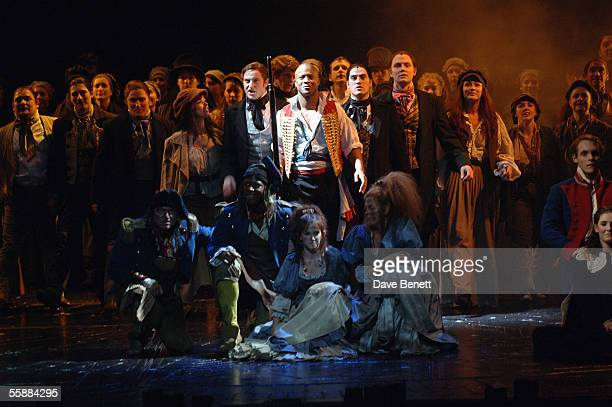 The cast perform on stage at the 20th Anniversary Celebration of Les Miserables show at the Queens Theatre on October 8 2005 in London England