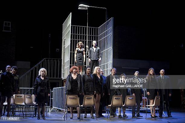 The cast perform on stage L'Opera de Quat ' Sous at the Comedie Francaise on March 31 2011 in ParisFrance