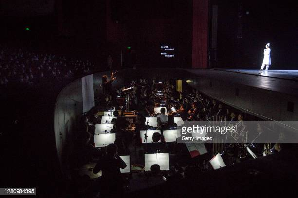 The cast play medical staff to treat patients of COVID19 as orchestra performance during the opera Angel's Diary on October 18 2020 in Wuhan Hubei...