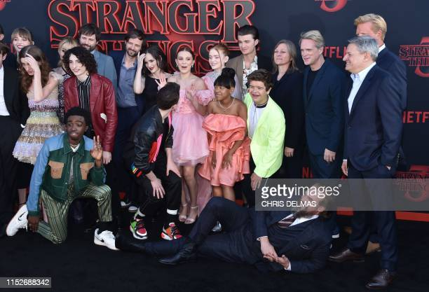 The cast pose on the carpet for Netflix's Stranger Things 3 premiere at Santa Monica high school Barnum Hall on June 28 2019 in Santa Monica...