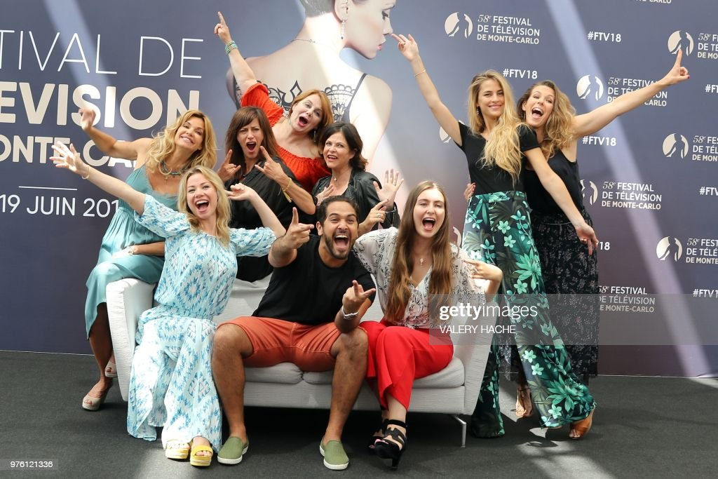 the cast poses during a photocall for the tv show demain nous