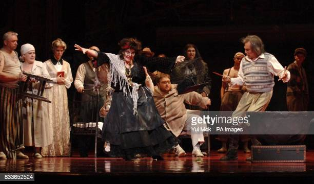 The cast rehearsing on stage during a photocall for The Fiery Angel by Sergei Prokofiev at The Royal Opera House in Covent Garden central London