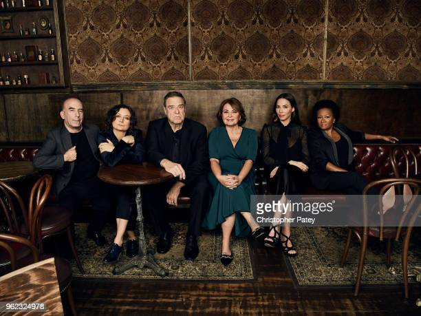 The cast Roseanne from left to right producer Bruce Helfrod actors Sara Gilbert John Goodman Roseanne Barr Whitney Cummings and Wanda Sykes are...