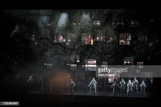 The cast wear personal protective equipment as they perform on stage during the opera Angel's Diary on October 18 2020 in Wuhan Hubei province China...