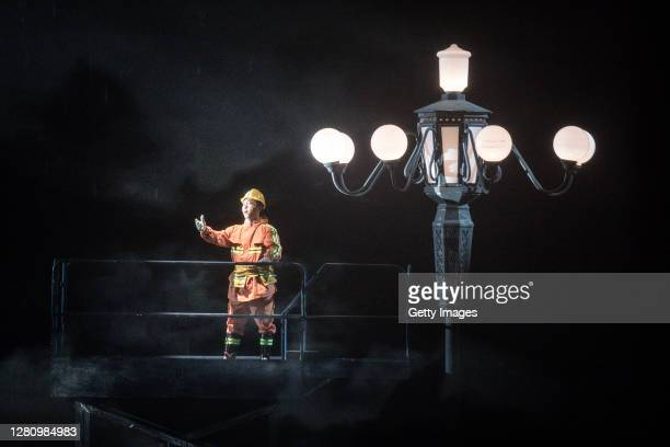 The cast wears personal protective equipment as they perform on stage during the opera Angel's Diary on October 18 2020 in Wuhan Hubei province China...