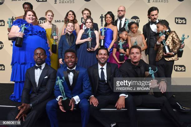 TOPSHOT The cast winner of Outstanding Performance by an Ensemble in a Drama Series for 'This Is Us' pose in the press room at the 24th Annual Screen...