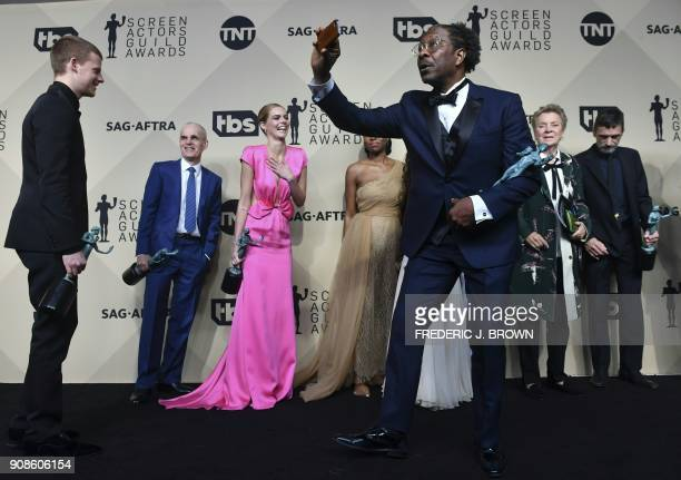 TOPSHOT The cast winners of Outstanding Performance by a Cast in a Motion Picture for 'Three Billboards Outside Ebbing Missouri' pose in the press...