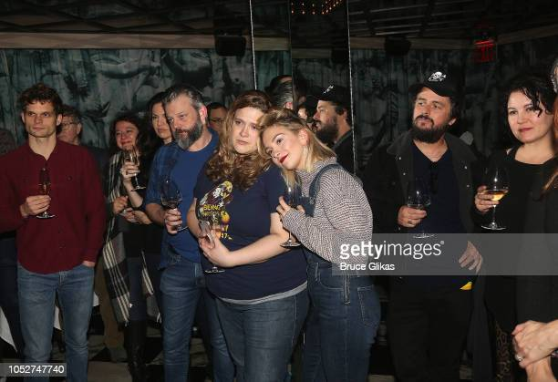 The cast with Billie Joe Armstrong and wife Adrienne Nesser listen to a speech at the 100th performance celebration for 'Head Over Heels' on Broadway...