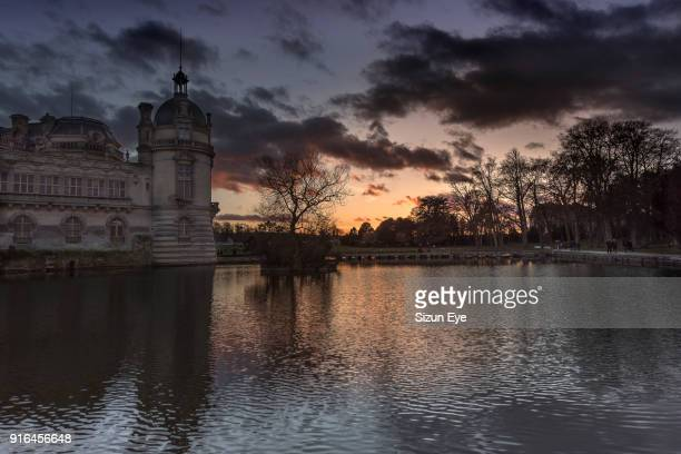 The castle Chateau de Chantilly after glow in December 2017, Oise department in France