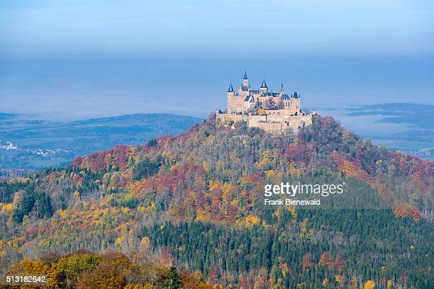 The castle Hohenzollern on a hill in colorful autumn landscape