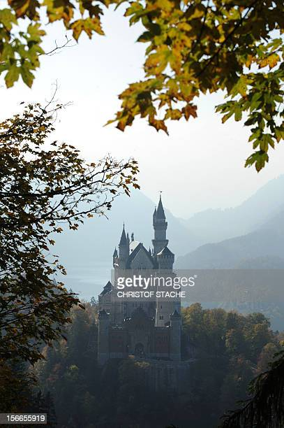The castle Neuschwanstein near Fuessen in the Allgaeu Alps mountains southern Germany is seen in autumn atmosphere and foggy weather on October 11...