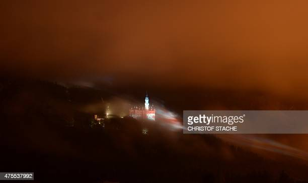 The castle Neuschwanstein near the small Bavarian village Fuessen southern Germany is illuminated in the national colors of the United Kingdom during...