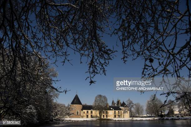 The castle of Chamerolles stands over a partiallyfrozen lake near Orleans some 120 km south of Paris on February 8 2018 / AFP PHOTO / CHRISTOPHE...