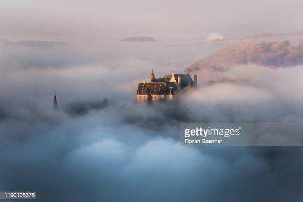The castle of Marburg is pictured in a foggy morning on December 20 2019 in Marburg Germany