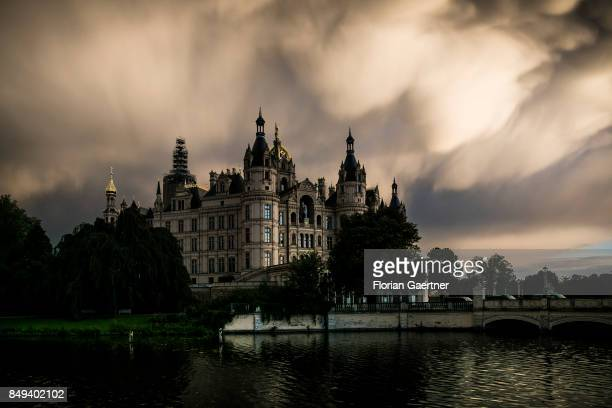 The castle of Schwerin is pictured in front of a coming storm on September 15 2017 in Schwerin Germany This castle is the chamber of the Landtag of...