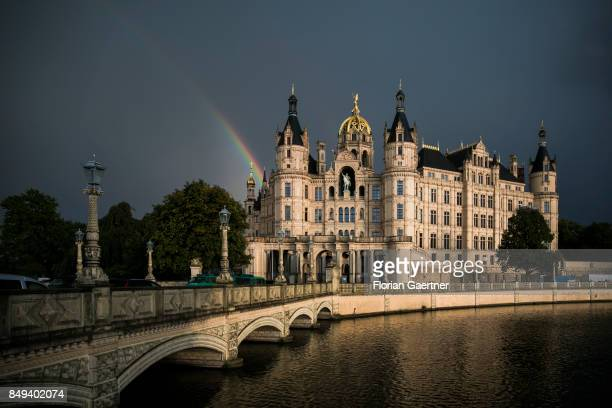 The castle of Schwerin is pictured in front of a rainbow on September 15 2017 in Schwerin Germany This castle is the chamber of the Landtag of...