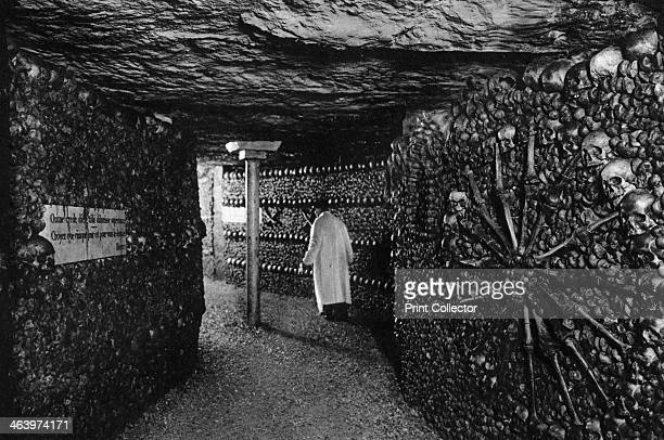The Catacombs Paris 1931 The Catacombs are old quarries which were converted into an Ossuary in 1786 Illustration from the book Paris by Ernest...